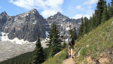 Canada-Alberta-Banff-Eiffel-Lake-Trail-hiker-stops-to-observe-cliffs-19