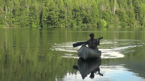 British-Columbia-Echo-Lake-man-approaches-in-canoe