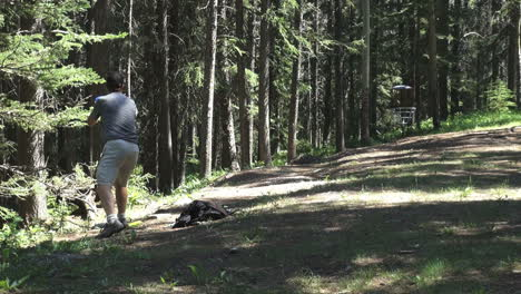 Canada-Alberta-Banff-disc-golf-course-putting-at-basket-8