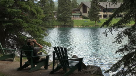 Canada-Alberta-Jasper-Lodge-wooden-chair-by-pond-17