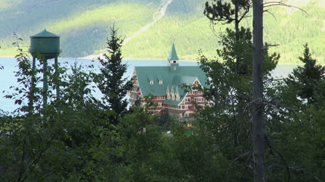 Canada-Alberta-Prince-of-Wales-Hotel-framed-with-trees-Waterton-Lakes-NP