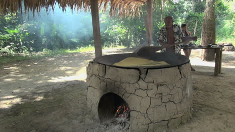 Amazon-village-man-preparing-manioc-or-cassava