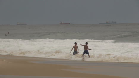 Rio-de-Janeiro-Ipanema-Beach-boys-play-in-waves