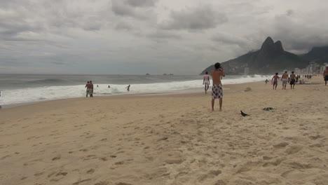 Rio-de-Janeiro-Ipanema-Beach-man-taking-photos-on-beach