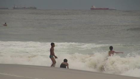 Rio-de-Janeiro-Ipanema-Beach-boys-in-waves