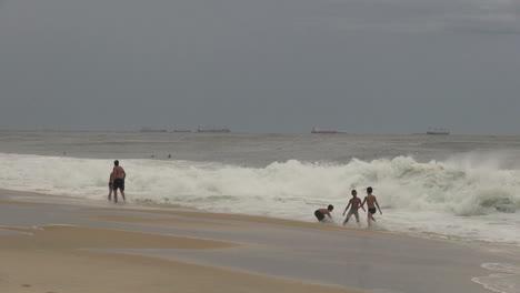 Rio-de-Janeiro-Ipanema-Beach-playing-in-surf