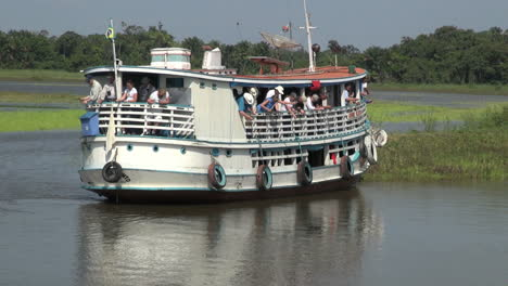 Brazil-Amazon-backwater-river-boat-with-tourists-fishing-s