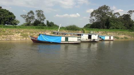 Brazil-Amazon-backwater-near-Santarem-three-boats-by-bank-s