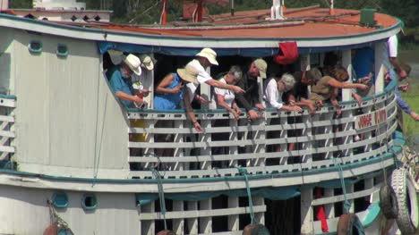 Brazil-Amazon-backwater-near-Santarem-tourists-fishing-from-river-boat-s