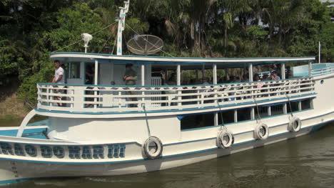 Brazil-Amazon-backwater-near-Santarem-boat-goes-by-s