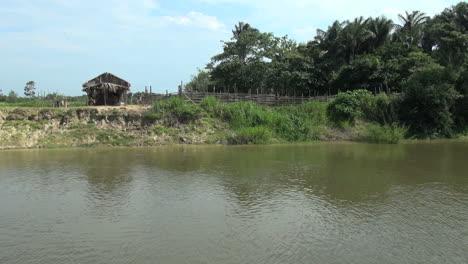 Brazil-Amazon-backwater-house-on-bank-s