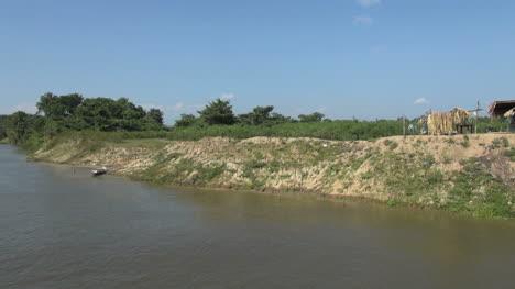 Brazil-Amazon-backwater-house-on-bank-with-fence-s