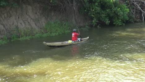 Brazil-Amazon-backwater-near-Santarem-man-in-canoe-s