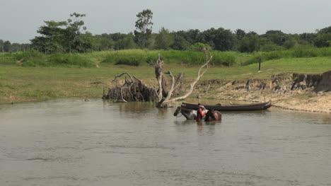 Brazil-Amazon-backwater-men-washing-horse-s