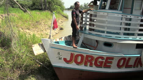 Brazil-Amazon-backwater-man-with-rope-and-boat-s