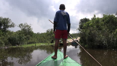 Amazon-boy-guides-canoe-toward-landing