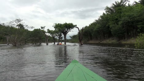 Amazon-canoe-follows-canoe-through-jungle