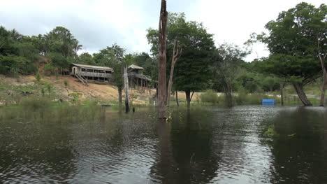 Brazil-Amazon-house-on-bank-seen-from-canoe
