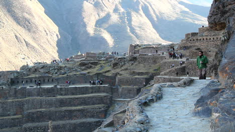 Peru-Sacred-Valley-Ollantaytambo-man-on-path-to-entrance-4