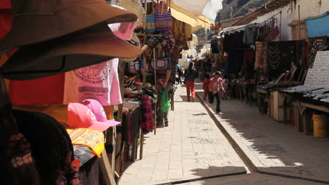 Peru-Pisac-market-paved-aisle-crowded-with-wares-8