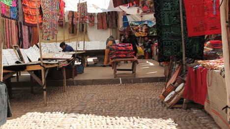 Peru-Pisac-market-with-fabrics-and-instruments-1