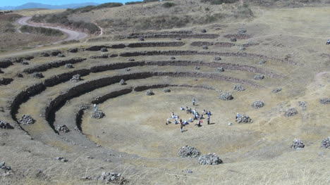 Peru-Moray-agricultural-terraces-with-tourists-in-center