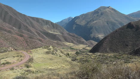Peru-Sacred-Valley-dirt-road-curves-down-rugged-valley-11