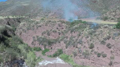 Peru-Sacred-Valley-blue-smoke-drifts-over-a-ravine-12