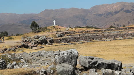 Peru-Sacsayhuaman-rows-of-walls-white-cross-and-hills-5