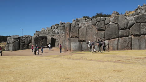 Peru-Sacsayhuaman-tourists-pass-walls-of-enormous-stones-6