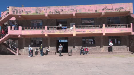 Peru-Taquile-people-on-steps-and-stairs-of-cooperative-building-9