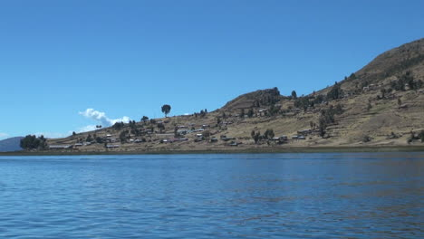 Peru-Taquile-ship-view-rising-slopes-and-terraced-community-16