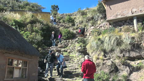 Peru-Taquile-tourists-on-steep-steps-on-hillside-23