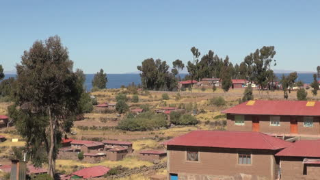 Peru-Taquile-terraces-and-red-tile-houses-near-lake-21