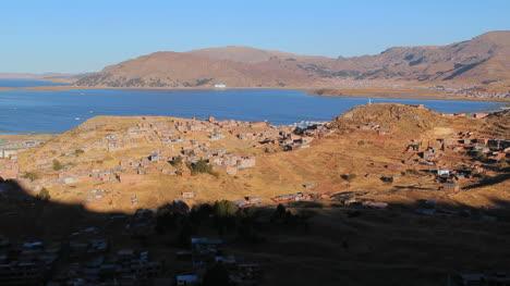 Peru-Lake-Titicaca-houses-spread-across-dry-hills