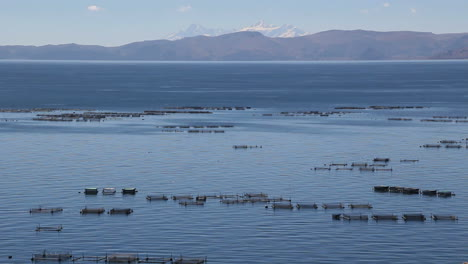 Peru-Lake-Titicaca-tranquil-water-and-fish-hatchery-boxes