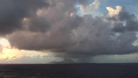 Bora-Bora-with-rain-shower-seen-from-sea