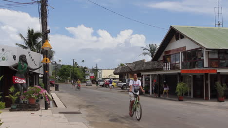 Bora-Bora-a-street-scene-with-cars-and-bicycles-in-Vaitape