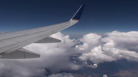 Greenland-wing-over-cumulus-clouds