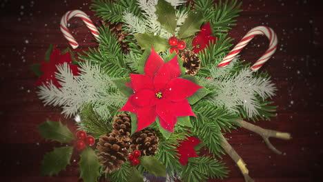 Primer-Plano-Animado-Copos-De-Nieve-Blancos-Sobre-Dulces-Y-Ramas-De-Navidad-Verdes