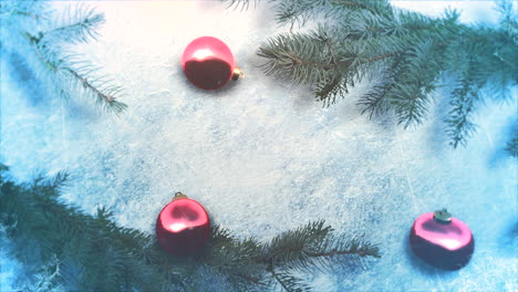 Animated-close-up-red-balls-and-Christmas-green-tree-branches-1