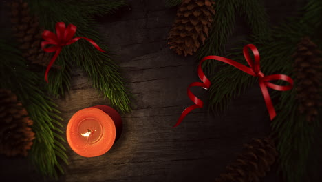Animated-close-up-Christmas-candle-and-green-tree-branches