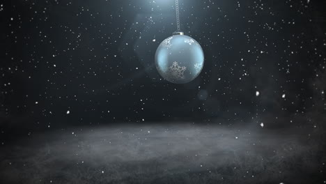 Animated-closeup-white-snowflakes-and-silver-ball-on-dark-background