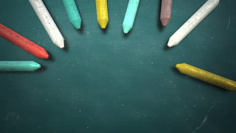 Closeup-colorful-chalk-on-blackboard-with-school-background