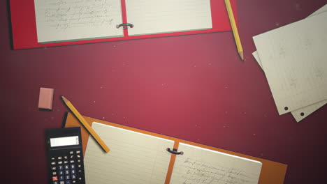 Closeup-table-of-student-with-notebook-and-calculator-school-background