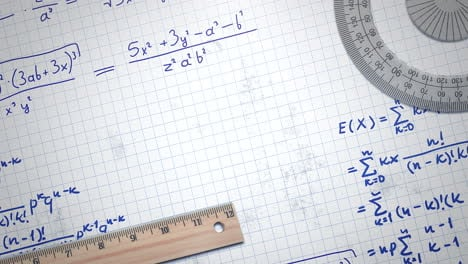 Closeup-mathematical-formula-and-elements-on-paper-school-background-2