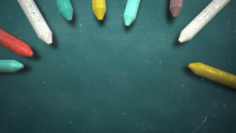 Closeup-colorful-chalk-on-blackboard-school-background-2