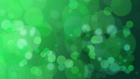 Abstract-green-bokeh-and-particles-falling