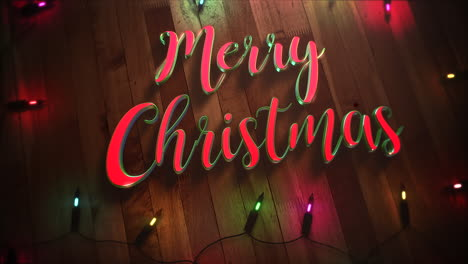 Merry-Christmas-text-and-colorful-garland-on-wood-background