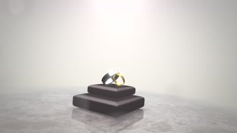 Closeup-rings-of-love-on-wedding-date-with-motion-background